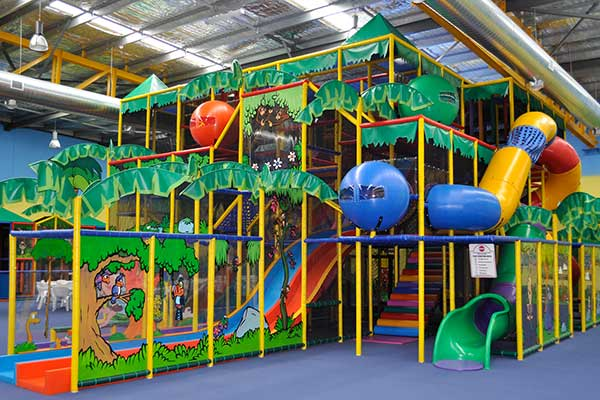 A side view of a large indoor kids playground.