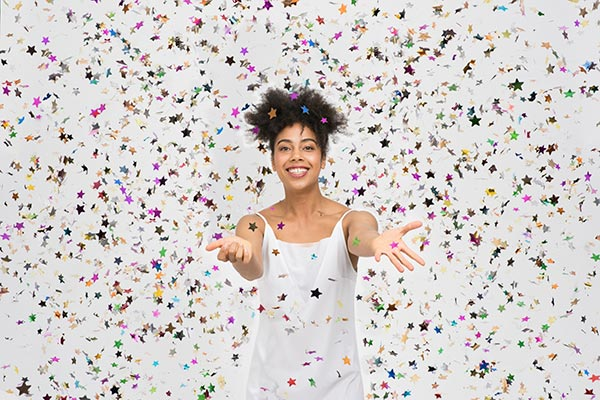 Smiling woman surrounded by glitter