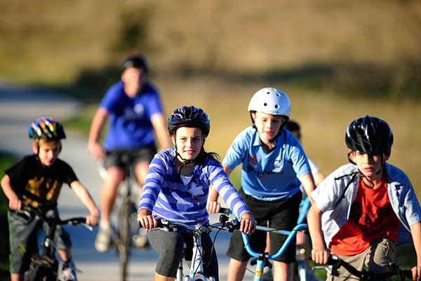 A group of children riding bicycles on a path
