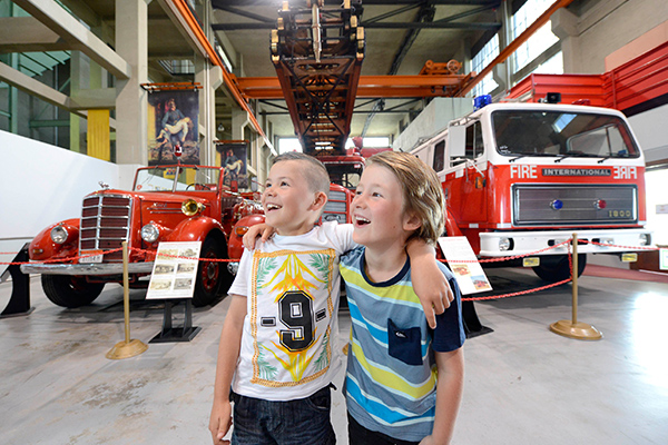 Two boys looking at fire engines at the Museum of Fire in Penrith