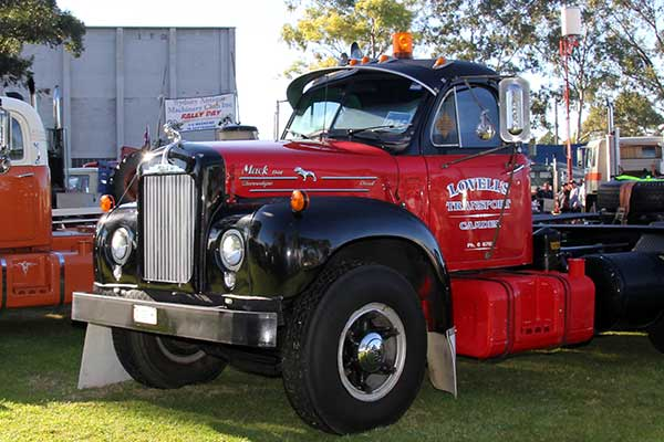 Red vintage truck on display in front of Museum of Fire
