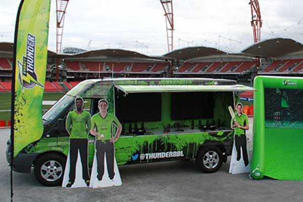 Sydney Thunder bright green van and slide
