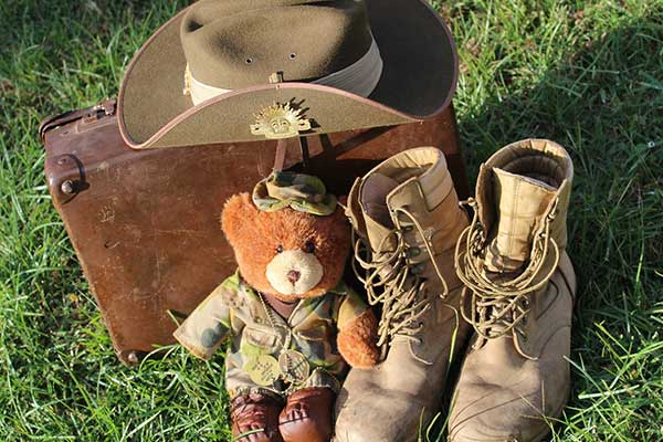 Army hat, boots and bear