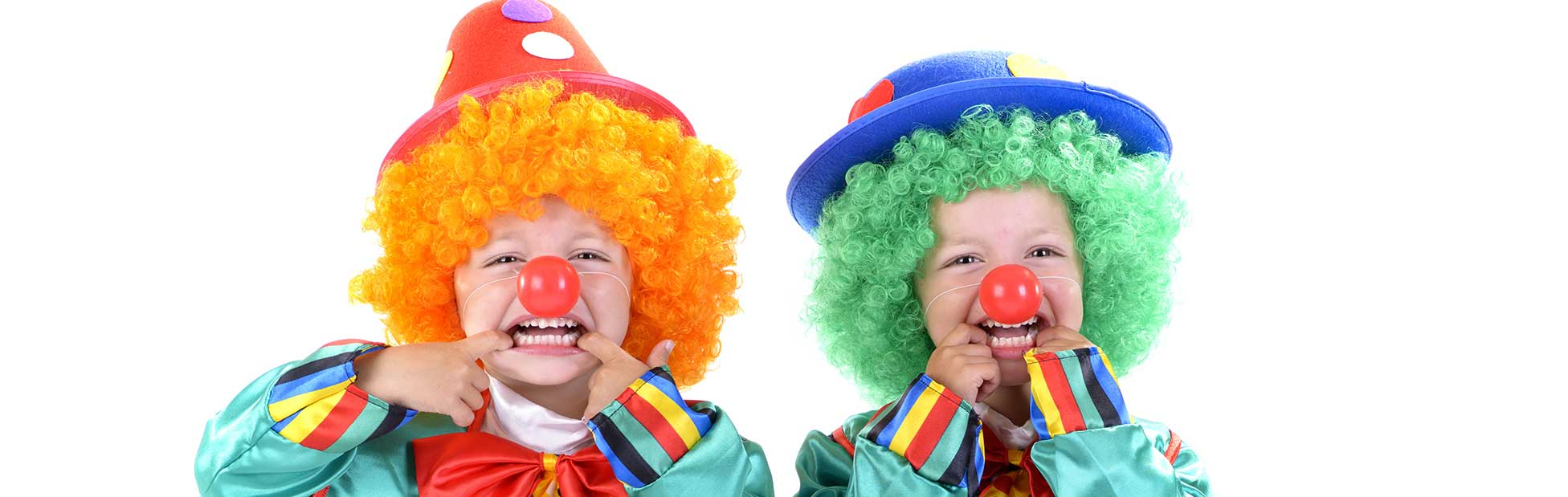 Two boys dressed as clowns pulling silly faces