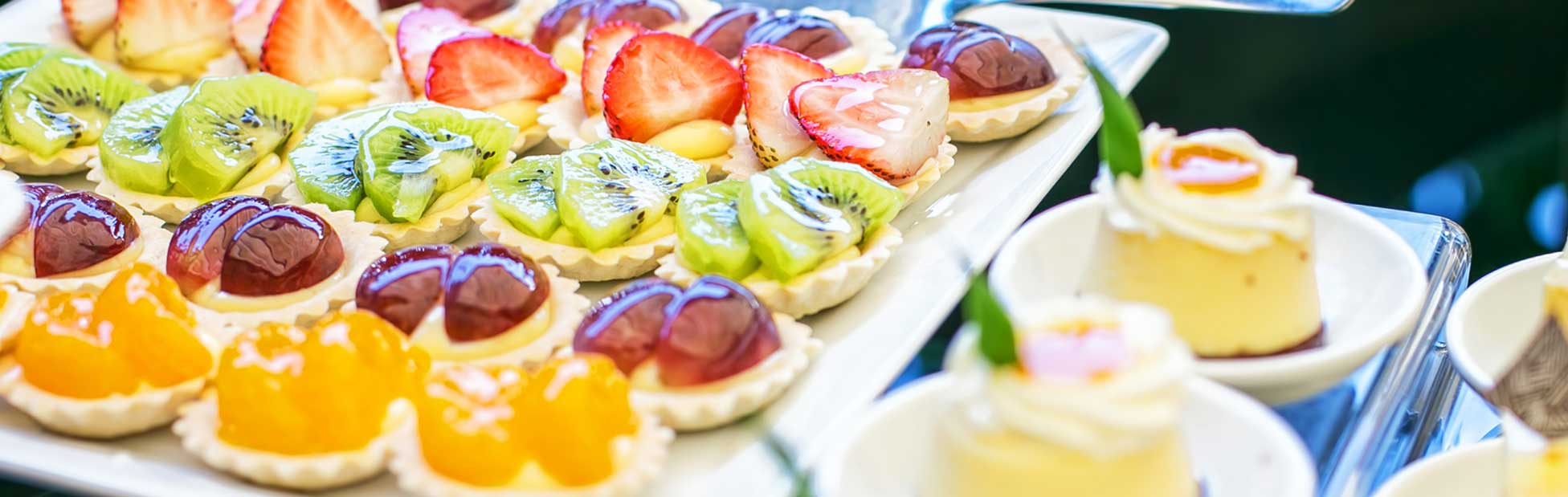 Variety of fruit topped treats on square plate