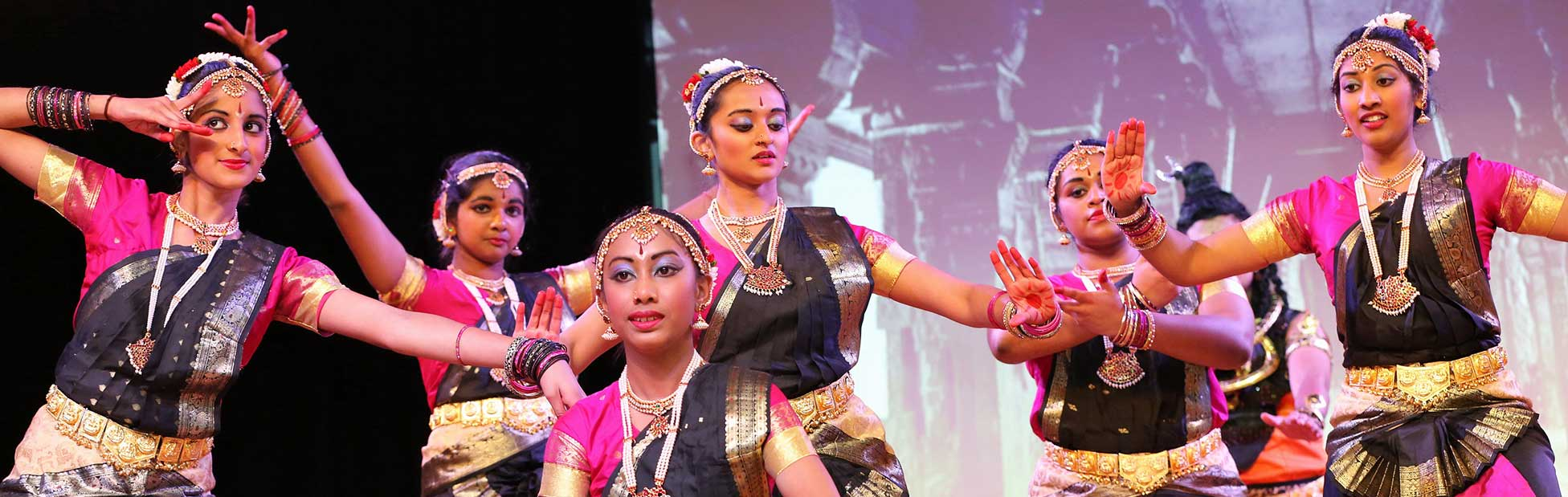 Indian dancers on stage performing
