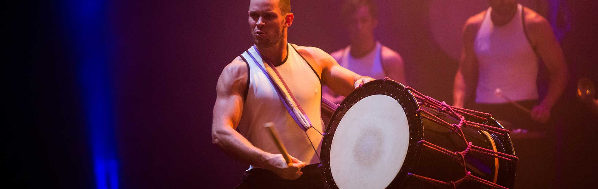 Man playing drum on stage