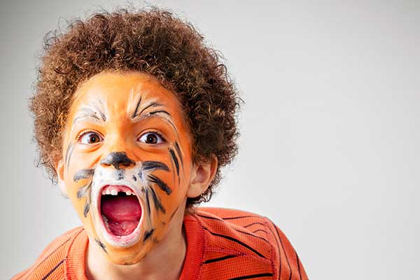 Boy with tiger facepaint