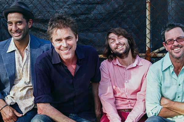 The Whitlams, four men posing for photo