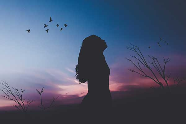 Woman silhouetted against sky