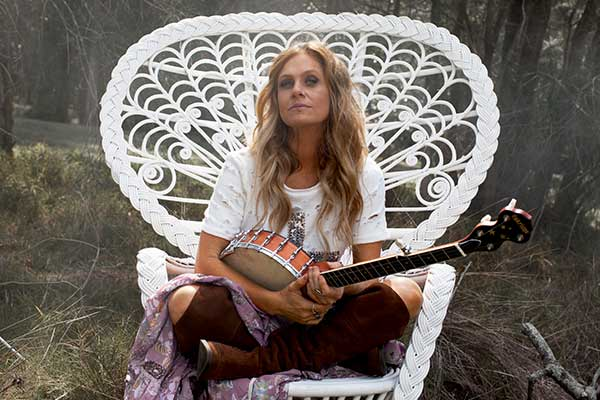 Kasey Chambers sitting in large white chair