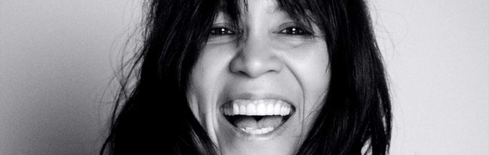 Close up black and white image of Kate Ceberano laughing
