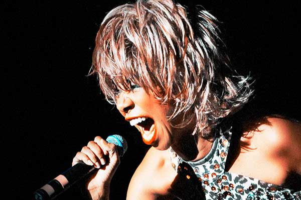Rebecca O'Connor looking like Tina Turner mid song