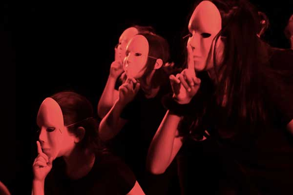 Performers wearing masks