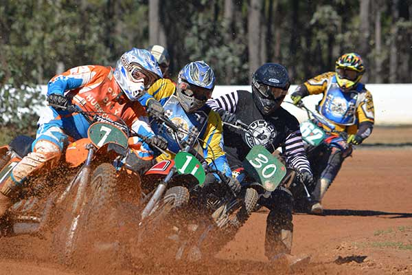 Motorcycles racing on dirt track