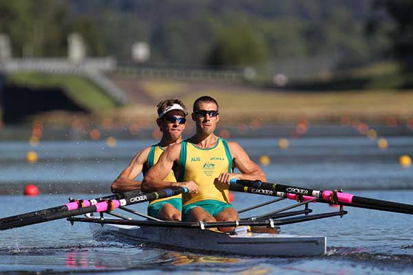 Two men rowing wearing Australian team colours