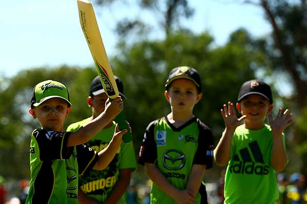four boys at cricket clinic