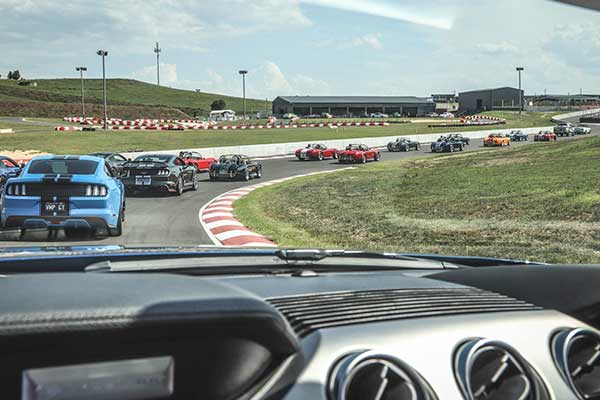 Cars on Racetrack, dash in foreground