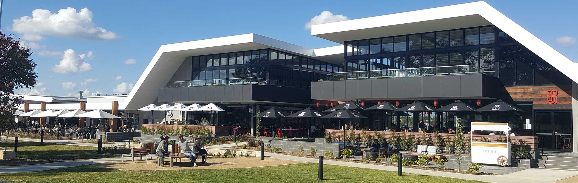 External view of river restaurant precinct on sunny day