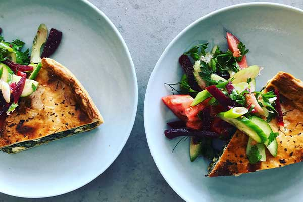 Quiche and salad on blue plate