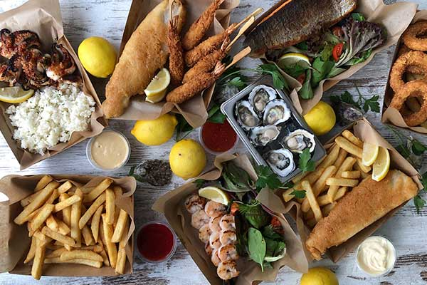 Spread of seafood including fish and chips