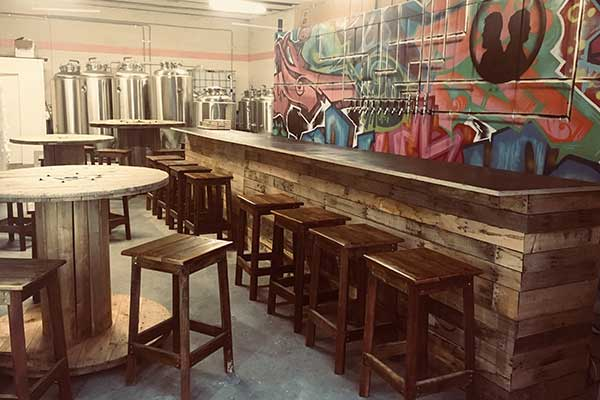 Empty bar surrounded by brewing tanks