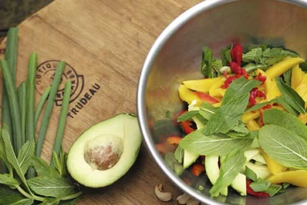 Fresh salad with avocado on board