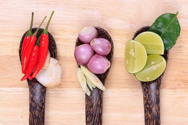 Chillis, onions and lime in bowls