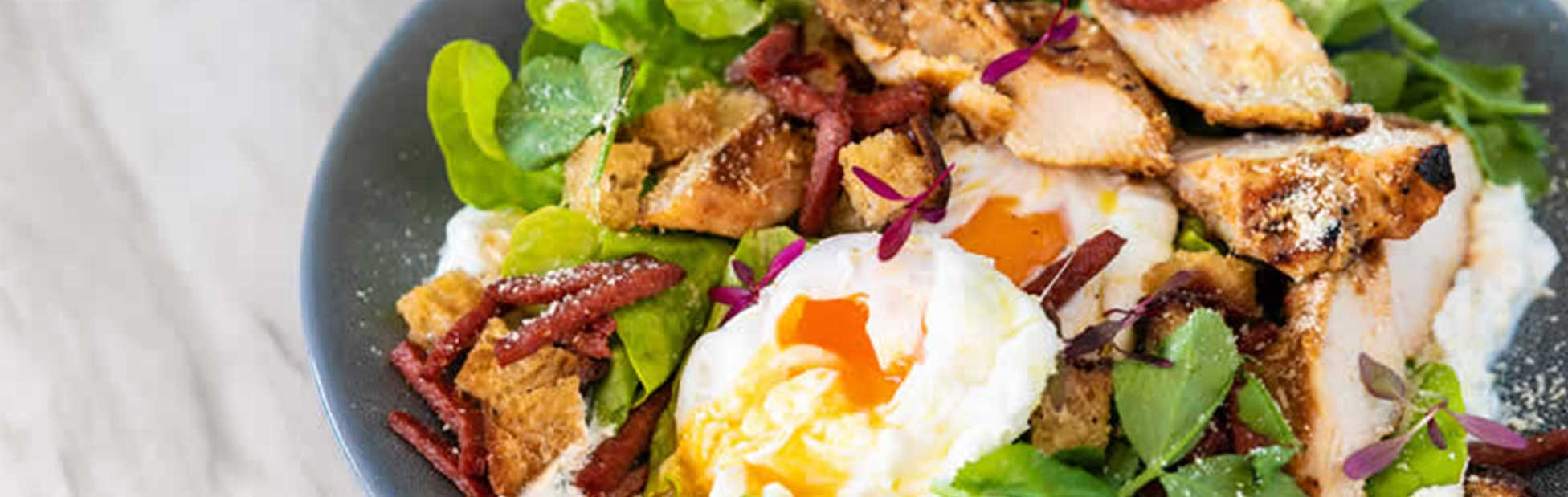 Salad in bowl with eggs