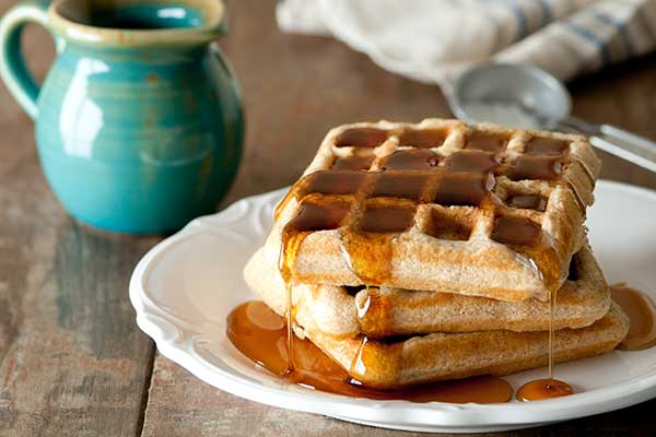 Waffles covered in maple syrup