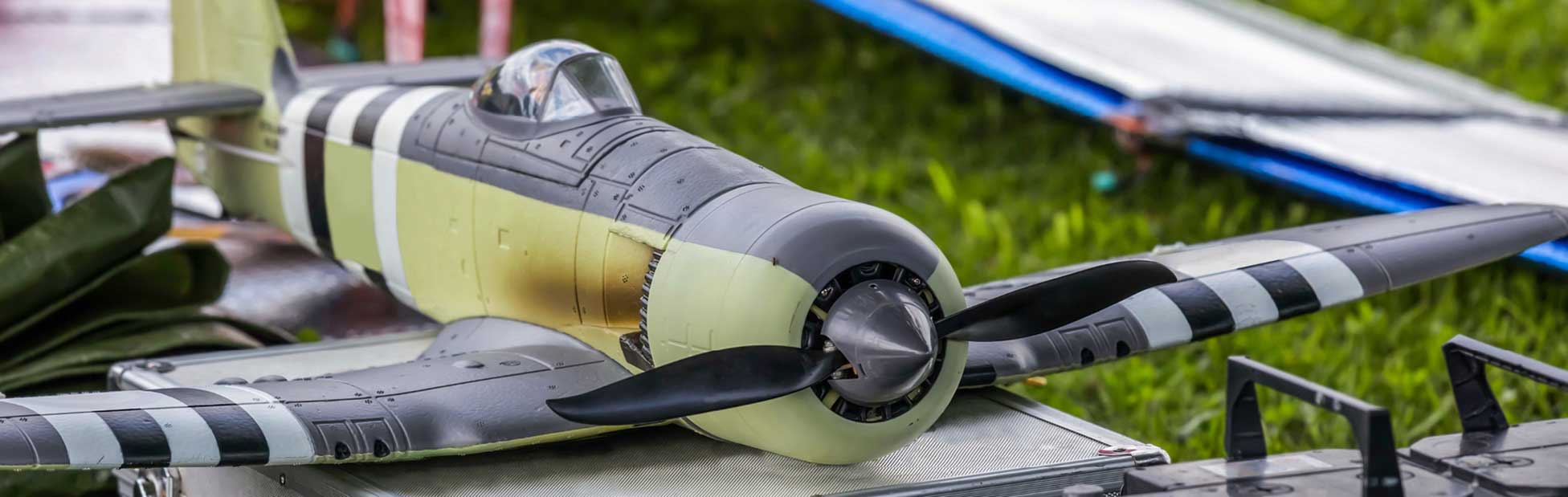 A model aeroplane sitting on the grass