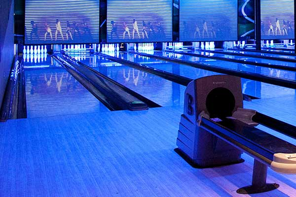 Bowling alley lit by blue lights