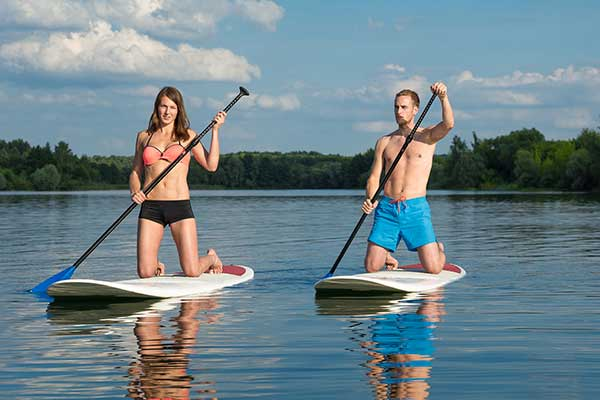 Young couple on Paddle board on the Nepean River